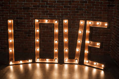Three-dimensional letter LOVE with glowing lights Stock Photo