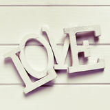 Three-dimensional letters forming the word love, filtered Royalty Free Stock Photos