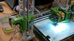 Three dimensional plastic 3d printer in laboratory. Automatic three dimensional 3d printer performs plastic modeling in laboratory. Modern 3D printing technology