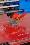 Three dimensional print. Closeup of three dimensional printing of plastic part Stock Image