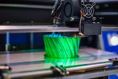 Three dimensional printing machine prints physical 3D model. 3D printer prints physical 3D model with plastic wire filament at modern technology exhibition stock images