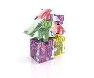 Three-dimensional puzzle house of banknotes Stock Images