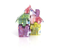 Three-dimensional puzzle house of banknotes Royalty Free Stock Images