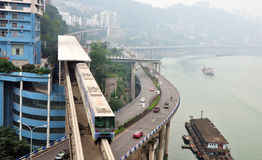 Three-dimensional traffic. The three-dimensional traffic ways-by light rail train,by driving cars and by water transport in Chongqing, China Stock Photography