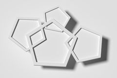 Three-dimensional white pentagons casting shadow Royalty Free Stock Image