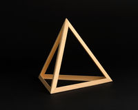 Three dimensional wooden triangle frame. Three dimensional wooden triangle in the form of an open sided frame with equilateral sides forming a geometric shape Royalty Free Stock Photo