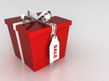 Three dimensional wrapped gift box with sale tag Royalty Free Stock Photography