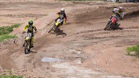 Three Dirt Bikes Battle a Corner Stock Photography