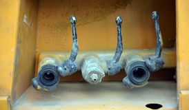 Three dirty water valves Stock Photos