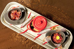 Three dishes. Holiday snacks in cups and a pot decorated with red chili Stock Photos