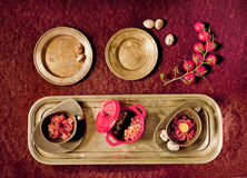 Three dishes. Holiday snacks on an old brass tray and branch of cherry tomatoes Royalty Free Stock Photography
