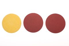 Three disks of sandpaper. On white background Royalty Free Stock Photo