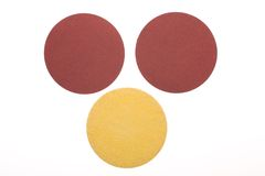 Three disks of sandpaper. On white background Stock Images