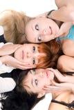 Three disturbed women touching their cheeks stock photography