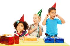 Group of kids and cake Stock Images