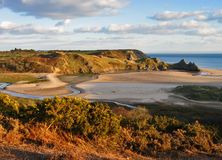 Three dliffs bay. Three cliffs bay, south wales, near sunset royalty free stock photo