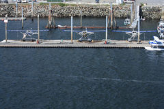 Three docked float planes in Ketchikan, Alaska Stock Photos