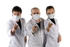 Three doctors. Stock Photo