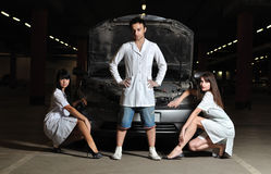 Three doctors in front of car Royalty Free Stock Images