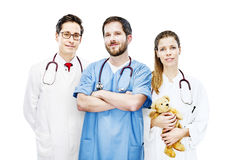 Three doctors group portrait modern clinic frontal team stock image