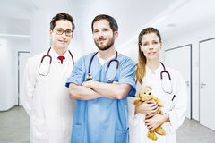 Three doctors group portrait modern clinic frontal team royalty free stock photo