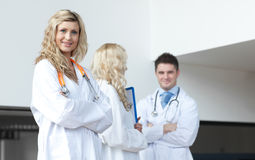 Three doctors in a hospital. Looking at camera Royalty Free Stock Photography