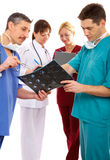 Three doctors and nurse Stock Images