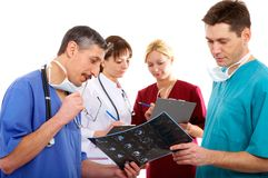 Three doctors and nurse Royalty Free Stock Photography
