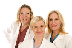 Three doctors or nurses in medical lab coats. Team of three happy and confident female doctors or nurses medical personnel wearing colorful scrubs clothes and Stock Image