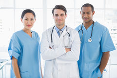 Three doctors standing together at hospital Stock Image
