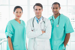 Three doctors standing together at hospital Stock Photography