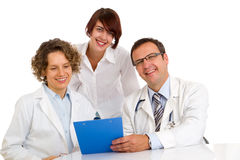 Three doctors write medical reports Royalty Free Stock Image