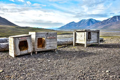 Three dog houses in Spitsbergen, Svalbard Stock Image