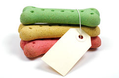 Three dog treats and a blank tag Stock Images