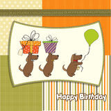 Three dogs that offer a big gift. Birthday greeting card Stock Photo