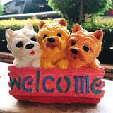 Dog welcome sign. Three dogs with welcome sign royalty free stock photo