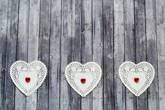 Three doily on wood background Royalty Free Stock Images