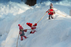Three dolls in the staged scenes in the snow Stock Images