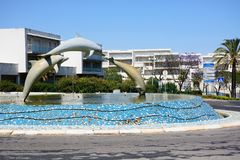 Dolphin traffic island, Albufeira. Three dolphin fountain in the centre of a traffic island, Albufeira, Portugal, Europe stock image