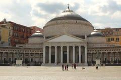 Three dome church in Napoli. Main square in Napoli, Italy, Piazza del Plebiscito with large church with roman design. The domes are reminiscent of byzantine Stock Photography