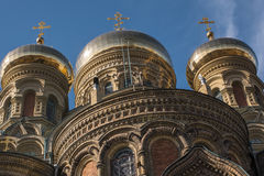 Three Domes of Naval Cathedral Over Clear Blue Sky. St. Nicholas Orthodox Naval Cathedral in Liepaja, Latvia. Close up of three golden domes. Sunny early spring Stock Photography