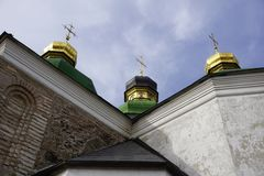 Three domes with three golden orthodox crosses on the roof of the temple Royalty Free Stock Image
