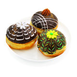 Three donuts with chocolate Stock Images