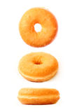 Three donuts in different positions Royalty Free Stock Images