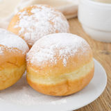 Three donuts sprinkled with powdered sugar Royalty Free Stock Image