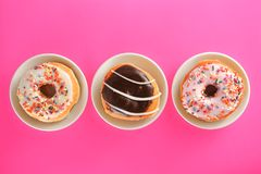 Donut breakfast food on pink background royalty free stock photo