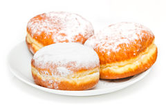 Three donuts on the white plate Royalty Free Stock Image