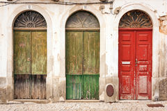 Three doors of  abandoned building. Royalty Free Stock Photography