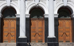 Three doors in building with columns Stock Photography