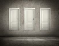 Three doors hanging on a wall Royalty Free Stock Image
